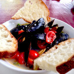 Drunken Mussels | White wine & garlic butter sauce, spinach & tomato, toast points.